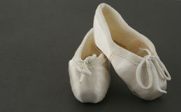 Tiny ballet shoes stock photography