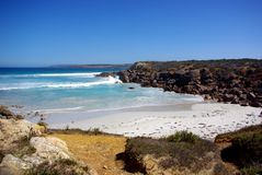 Tiny Bay, Eyre Peninsula. A tiny bay on the Eyre Peninsula, with a roaring ocean between brutal cliffs (Australia Stock Images
