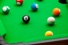 Tiny billiards game toy Stock Photography