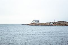 Tiny blue lighthouse on swedish coastline. Pastel shades of blue Stock Photography