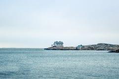 Tiny blue lighthouse on swedish coastline. Pastel shades of blue Royalty Free Stock Image