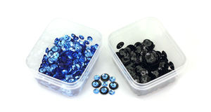 Tiny Blue and Regular Black Sequins Stock Photography