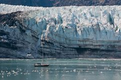 Tiny boat and glacier Stock Photography