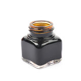 Tiny bottle filled with black ink Stock Photo