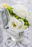 Tiny bouquet of white eustoma flowers and green hypericum plant Stock Images