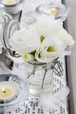Tiny bouquet of white eustoma flowers and green hypericum plant Stock Image