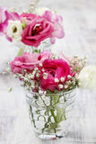 Tiny bouquets in glass vases. Wedding floral decorations stock photography