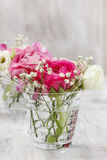 Tiny bouquets in glass vases. Wedding floral decorations Royalty Free Stock Image