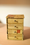 Miniature Decorative Box with Drawers. Small cardboard gift or souvenir box with drawers decorated with flowers and vintage writing for holding jewelry or Stock Images