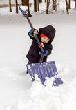 Tiny boy trying to shovel snow Stock Photography