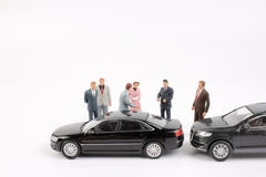 Tiny Business figure and toy car Stock Image