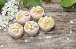 Tiny cakes on wooden background Stock Photography