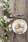 Tiny cakes on wooden background, springtime set. Royalty Free Stock Photos