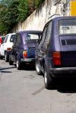 Tiny Car Park. Three generation of tiny italian cars parked on the same street in Sicily Italy Royalty Free Stock Image