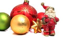 Tiny ceramic Santa Claus Christmas balls Stock Photography