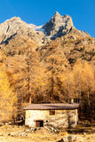 Tiny chalet in the italian Alps with a colourful panorama. Under a peak. Val camonica Royalty Free Stock Images