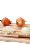 Tiny chopped onions on a kitchen wooden board Royalty Free Stock Images