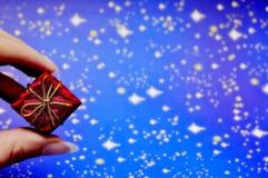 Tiny Christmas gift for you Stock Photos