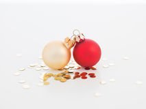 Tiny christmas globes joined together. Closeup of tiny christmas globes joined together with golden sequins arround them  on white Stock Images