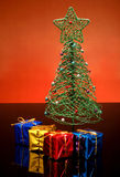 Tiny Christmas tree and gifts Royalty Free Stock Photo