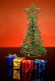 Tiny Christmas tree and gifts Royalty Free Stock Photo