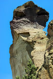 Tiny Climbers On Overhanging Cliff Royalty Free Stock Images