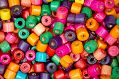 Tiny colored wooden beads closeup. Royalty Free Stock Photo