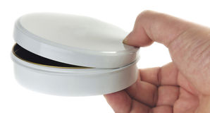 Tiny container. In a hand on a white background Royalty Free Stock Images