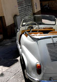 Tiny Convertible. A tiny italian convertible parked on a steep and narrow alley in Sicily Italy Stock Photo