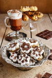 Tiny cookies in flower shape and cup of hot chocolate Stock Image