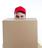 Tiny courier. Funny small delivery man holding heavy boxes - front view - isolated on white Royalty Free Stock Images