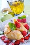 Tiny croissants with raspberries Stock Photo