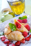 Tiny croissants with raspberries. Fresh little croissants with raspberries Stock Photo