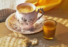 Tiny cup of coffee and small glass with sea-buckthorn liqueur Royalty Free Stock Photography