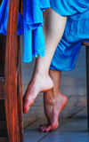 Tiny Dancer at Rest. Legs of dancer at rest after performance in Costa Rican Cafe stock photos