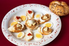 Tiny decorated sandwiches with vegetable spread, egg and cheese Royalty Free Stock Images