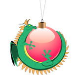 Tiny dragon with christmas ball Royalty Free Stock Photos