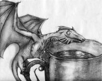 Tiny dragon on the cup - sketch. Tiny dragon with sly face sitting at the edge of a cup with some drink. Pencil drawing Stock Photo
