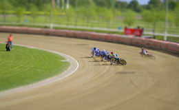 Tiny Drivers. Photo taken on speedway track stock photos