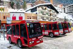 Tiny electric shuttles in Zermatt, Swizerland Stock Photo