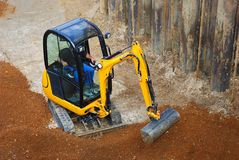 Tiny excavator Royalty Free Stock Images