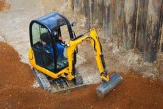 Tiny excavator Royalty Free Stock Images