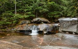 Tiny Falls. A small waterfall located just above Screw Auger Falls in Grafton Notch State Park in Maine Stock Images