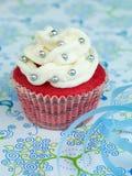 Tiny fancy velvet cupcake Stock Photos