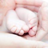 Tiny feet Royalty Free Stock Photo