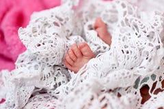 Tiny feet of a newborn Stock Photography
