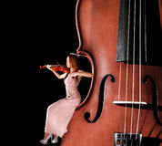 Tiny female violinist Stock Photos