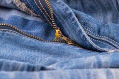 The tiny figure unzip, zip zipper jeans. Garden work concept Royalty Free Stock Image