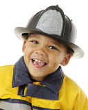 Tiny Fire Fighter Stock Photo