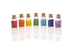 Tiny glass bottles filled with colourful beads Royalty Free Stock Image